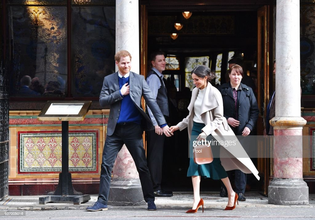 Prince Harry and Meghan Markle leave the Crown Liquor Saloon, a former Victorian gin palace owned by the National Trust, on March 23, 2018 in Belfast, Nothern Ireland.