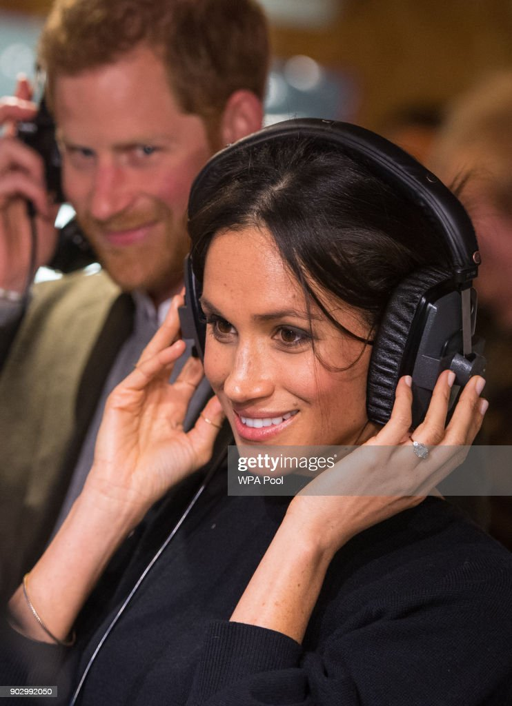 Prince Harry and Meghan Markle listen to a broadcast through headphones at Reprezent 107.3FM in Pop Brixton on January 9, 2018 in London, England. The Reprezent training programme was established in Peckham in 2008, in response to the alarming rise in knife crime, to help young people develop and socialise through radio.