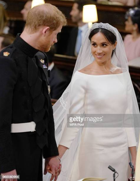 Prince Harry and Meghan Markle look at each other during their wedding service in St George's Chapel at Windsor Castle on May 19 2018 in Windsor...