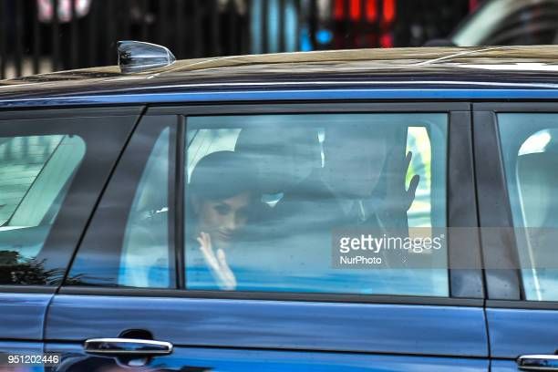 Prince Harry and Meghan Markle make their way out after attending an Anzac Day Service of Commemoration and Thanksgiving at Westminster Abbey London...