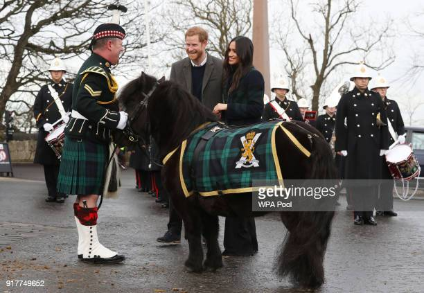 Prince Harry and Meghan Markle meet Pony Major Mark Wilkinson and regimental mascot Cruachan IV during a walkabout on the esplanade at Edinburgh...