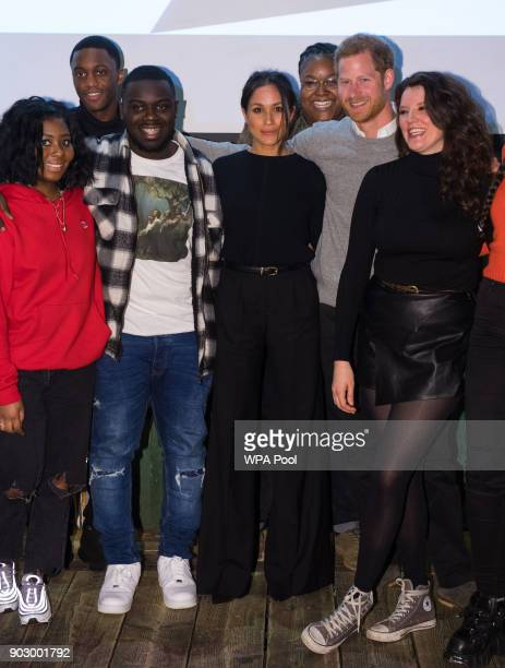 Prince Harry and Meghan Markle pose during a visit to Reprezent 1073FM in Pop Brixton on January 9 2018 in London England The Reprezent training...
