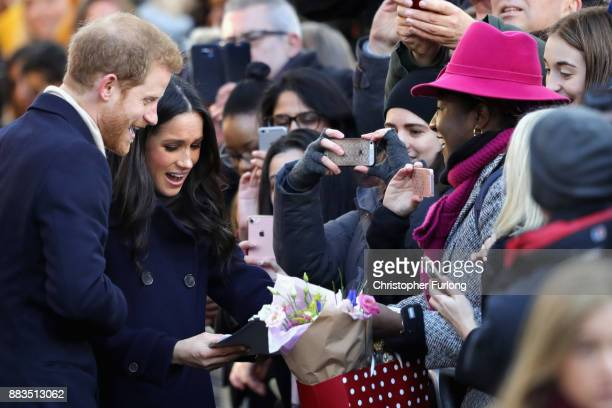 Prince Harry and Meghan Markle receive gifts from members of the public as they visit Nottingham Contemporary on December 1 2017 in Nottingham...