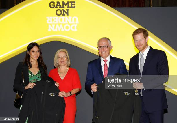 Prince Harry and Meghan Markle receive Invictus Games jackets from Malcolm Turnbull Prime Minister of Australia and his wife Lucy Turnbull during the...