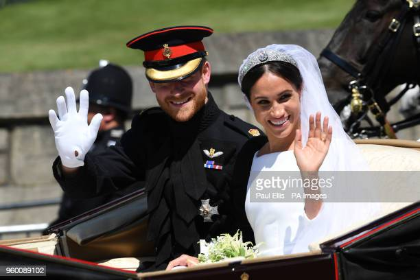 Prince Harry and Meghan Markle ride in an Ascot Landau after their wedding ceremony to Prince Harry at St George's Chapel in Windsor Castle