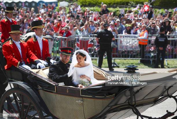 Prince Harry and Meghan Markle ride in an Ascot Landau after their wedding ceremony at St George's Chapel in Windsor Castle