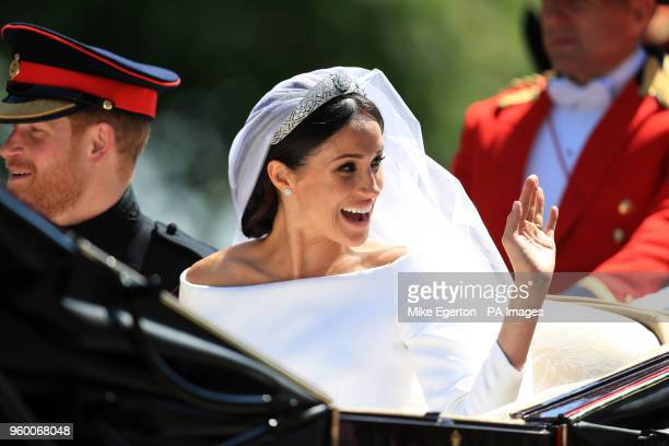 Prince Harry and Meghan Markle ride in an Ascot Landau along the Long Walk after their wedding in St George's Chapel in Windsor Castle
