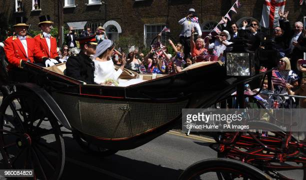 Prince Harry and Meghan Markle ride in an Ascot Landau through Windsor after their wedding in St George's Chapel in Windsor Castle