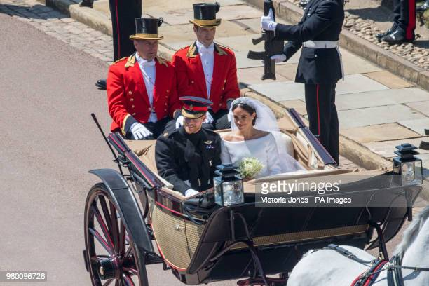Prince Harry and Meghan Markle ride through Windsor in an Ascot Landau carriage after their wedding ceremony at St George's Chapel in Windsor Castle