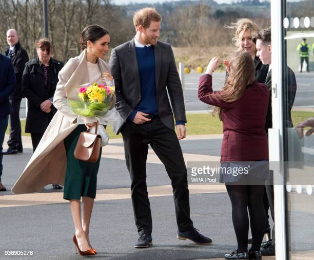 Prince Harry and Meghan Markle speak to student Amber Hamilton and Secretary of State for Northern Ireland Karen Bradley during their visit to the...