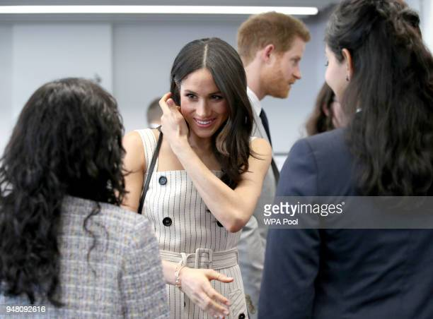 Prince Harry and Meghan Markle speak with delegates from the Commonwealth Youth Forum at the Queen Elizabeth II Conference Centre during the...