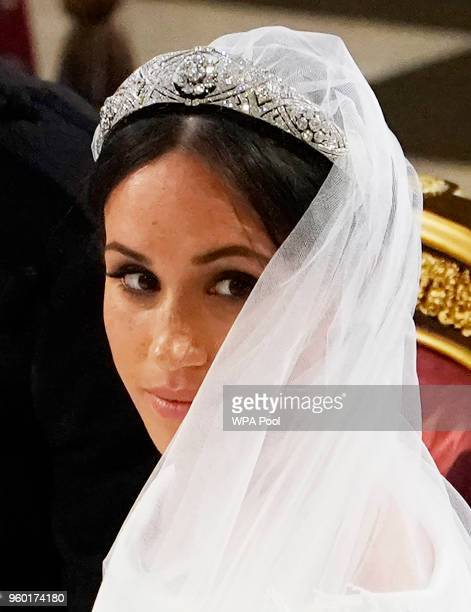 Prince Harry and Meghan Markle stand at the altar at St George's Chapel on May 19, 2018 in Windsor, England.
