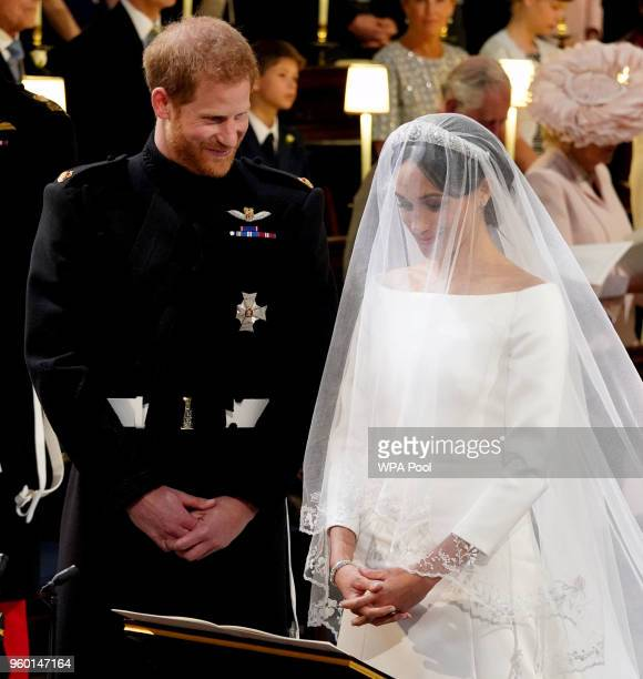 Prince Harry and Meghan Markle stand at the altar during their wedding in St George's Chapel at Windsor Castle on May 19 2018 in Windsor England