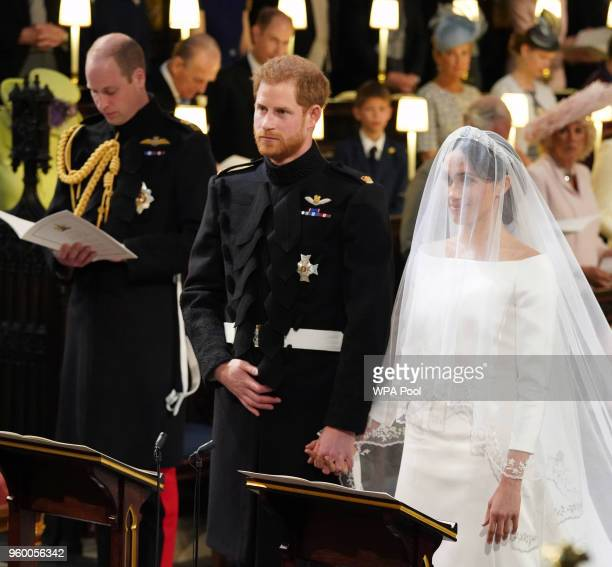 Prince Harry and Meghan Markle stand together during their marriage in St George's Chapel at Windsor Castle on May 19, 2018 in Windsor, England.