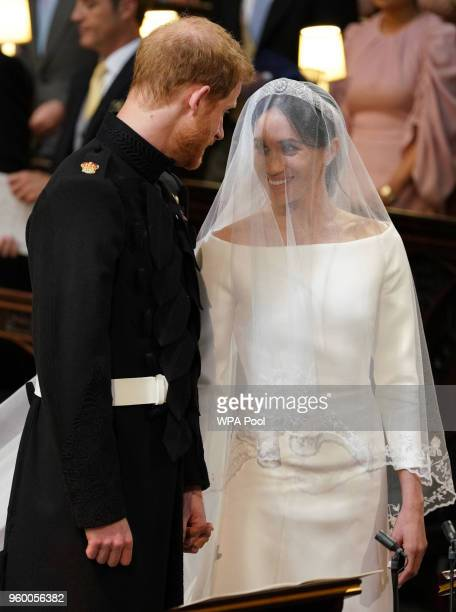 Prince Harry and Meghan Markle stand together during their marriage in St George's Chapel at Windsor Castle on May 19 2018 in Windsor England