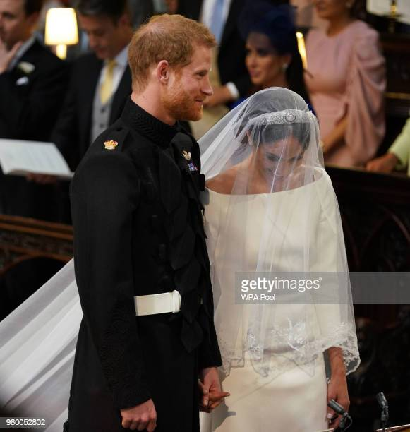 Prince Harry and Meghan Markle stand together in St George's Chapel at Windsor Castle for their wedding on May 19 2018 in Windsor England