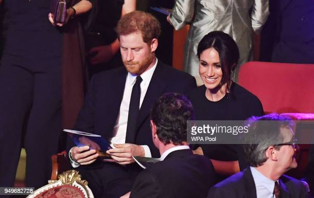 Prince Harry and Meghan Markle take their seats at a starstudded concert to celebrate the Queen's 92nd birthday at the Royal Albert Hall on April 21...