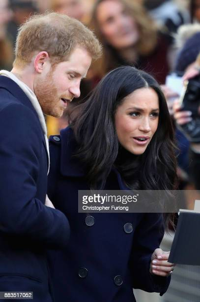 Prince Harry and Meghan Markle talk to members of the public as they visit Nottingham Contemporary on December 1 2017 in Nottingham England Prince...