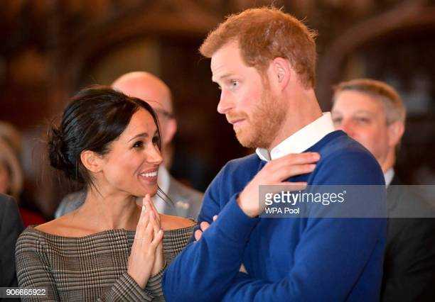 Prince Harry and Meghan Markle watch a dance performance by Jukebox Collective in the banqueting hall during a visit to Cardiff Castle on January 18...