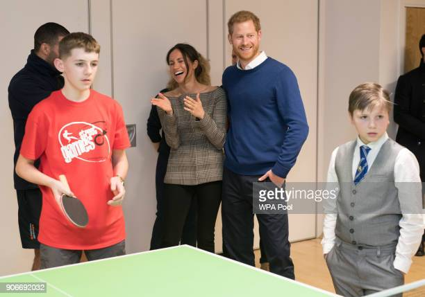 Prince Harry and Meghan Markle watch a game of table tennis during their visit to Star Hub on January 18 2018 in Cardiff Wales
