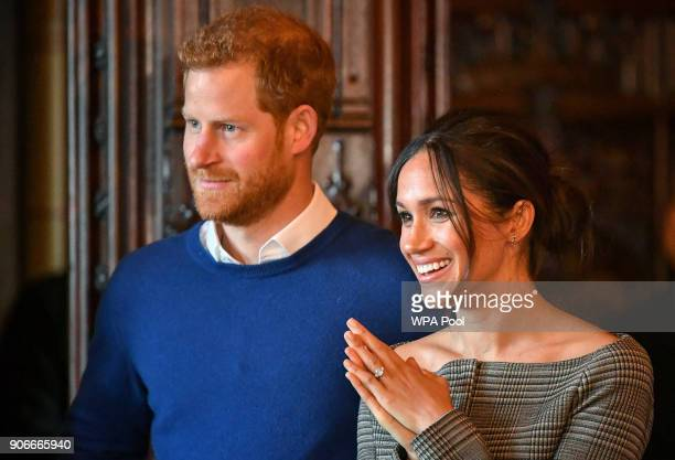 Prince Harry and Meghan Markle watch a performance by a Welsh choir in the banqueting hall during a visit to Cardiff Castle on January 18, 2018 in...