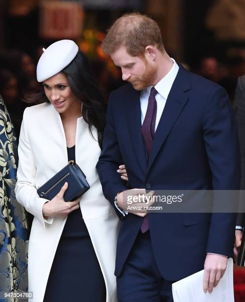 Prince Harry and Meghan Markle wearing a cream Amanda Wakeley coat and matching hat attend the Commonwealth Service at Westminster Abbey on March 12...