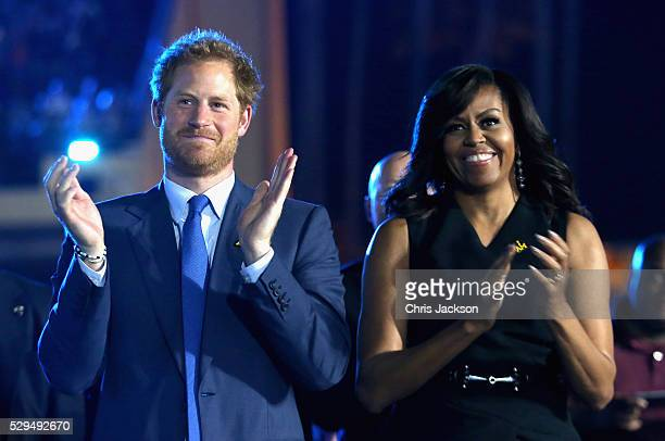 Prince Harry and Michelle Obama cheer during the Opening Ceremony of the Invictus Games Orlando 2016 at ESPN Wide World of Sports on May 8 2016 in...