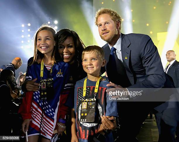 Prince Harry and Michelle Obama meet children of servicemen and women during the Opening Ceremony of the Invictus Games Orlando 2016 at ESPN Wide...