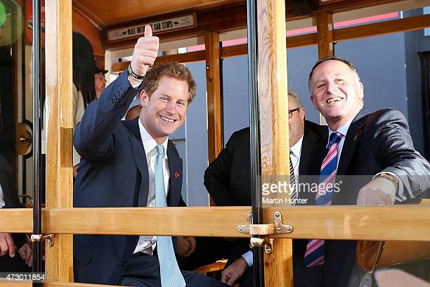 Prince Harry and New Zealand Prime Minister John Key ride on a tram on May 12 2015 in Christchurch New Zealand Prince Harry is in New Zealand from...
