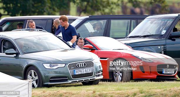 Prince Harry and Peter Phillips prepare to leave the Beaufort Polo Club after attending the Goldin Metropolitan Polo Club Charity Cup polo match on...
