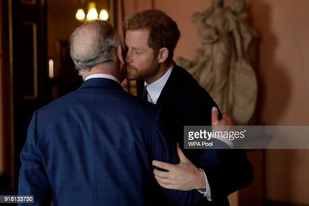 Prince Harry and Prince Charles Prince of Wales arrive to attend the 'International Year of The Reef' 2018 meeting at Fishmongers Hall on February 14...