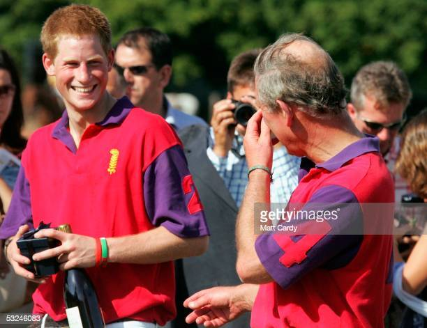 Prince Harry and Prince Charles share a joke at the presentation following the Highgrove Polo Team match against Laird polo team in the St James...