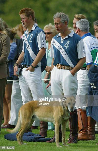 Prince Harry and Prince Charles stand sidebyside during the presentation of The Ronnie Wallace Memorial match at Beaufort Polo Club in Westonbirt on...