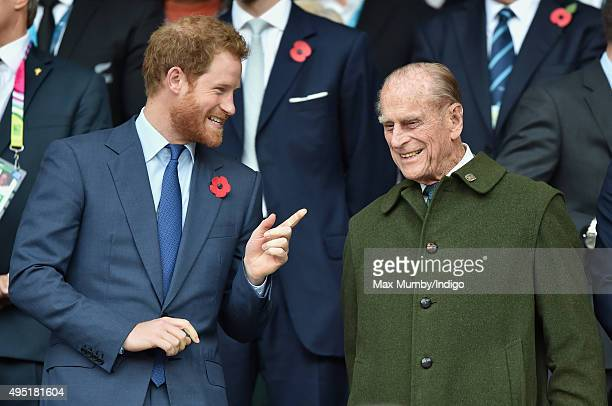 Prince Harry and Prince Philip, Duke of Edinburgh attend the 2015 Rugby World Cup Final match between New Zealand and Australia at Twickenham Stadium...