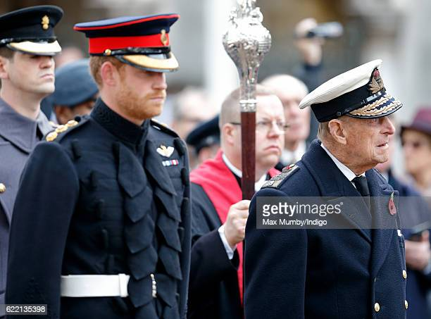 Prince Harry and Prince Philip Duke of Edinburgh attend the opening of the Field of Remembrance at Westminster Abbey on November 10 2016 in London...
