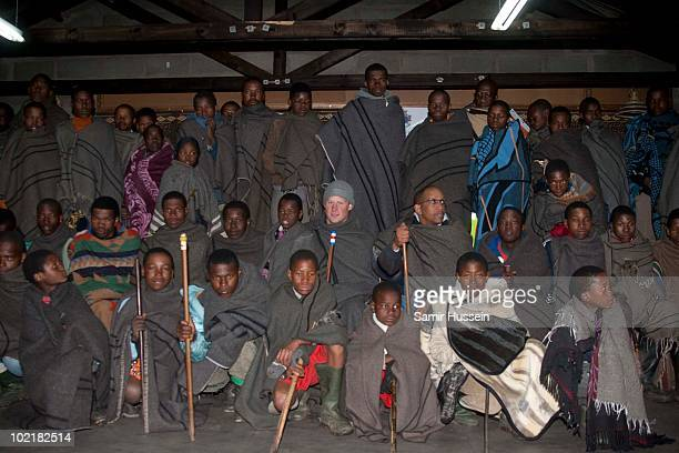 Prince Harry and Prince Seeiso wear warm blankets at the Herd Boy School on June 17 2010 in Semonkong Lesotho The Princes are on a joint trip to...