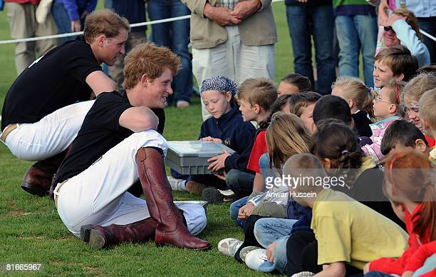 Prince Harry and Prince William chat to local children after competing in a charity polo match at the the Beaufort Polo Cub on June 22 2008 in...
