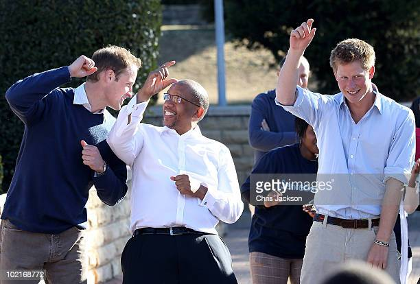 Prince Harry and Prince William dance with Prince Seeiso as they visit the Mamahato Network Club for children affected by HIV at King Letsie's Palace...