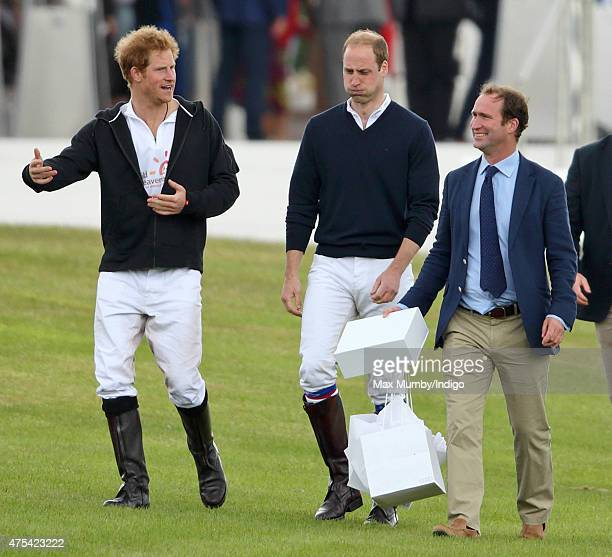 Prince Harry and Prince William Duke of Cambridge accompanied by their Polo Manager Andrew Tucker attend day 2 of the Audi Polo Challenge at Coworth...