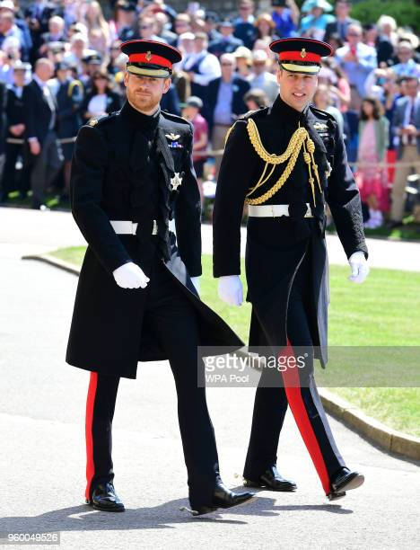 Prince Harry and Prince William Duke of Cambridge arrive at St George's Chapel at Windsor Castle before the wedding of Prince Harry to Meghan Markle...