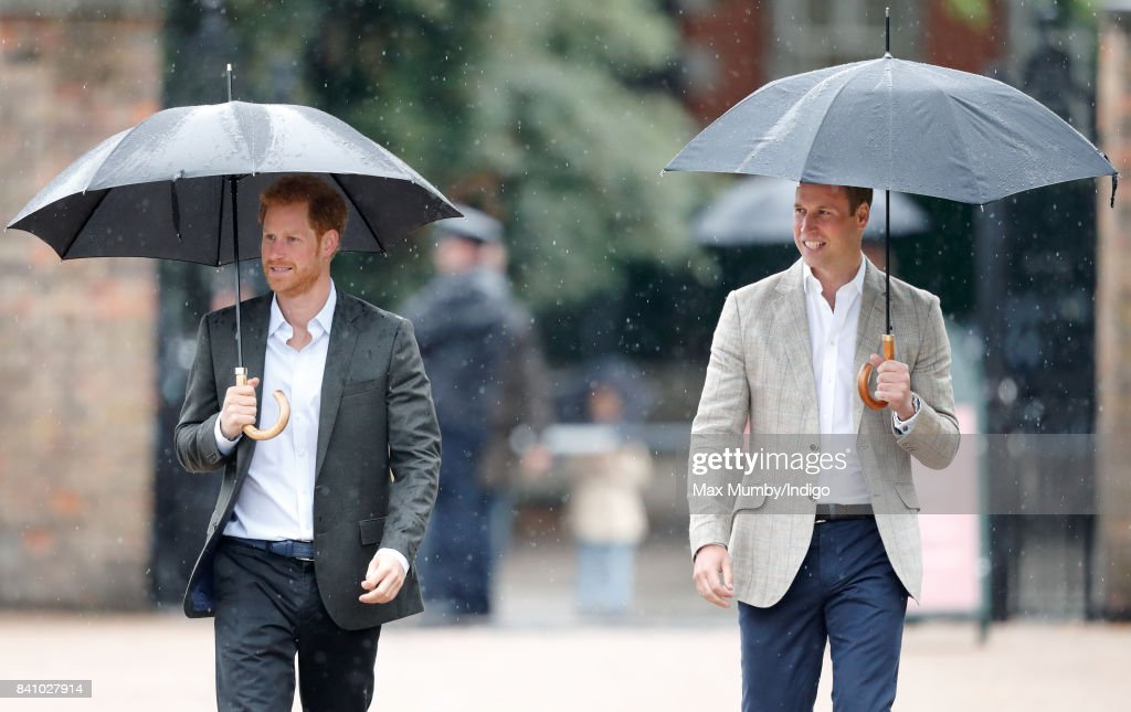 Prince Harry and Prince William, Duke of Cambridge arrive to view tributes to Diana, Princess of Wales left at the gates of Kensington Palace after visiting the Sunken Garden on August 30, 2017 in London, England. The Sunken Garden has been transformed into a White Garden dedicated to Diana, Princess of Wales mother of The Duke of Cambridge and Prince Harry marking the 20th anniversary of her death.