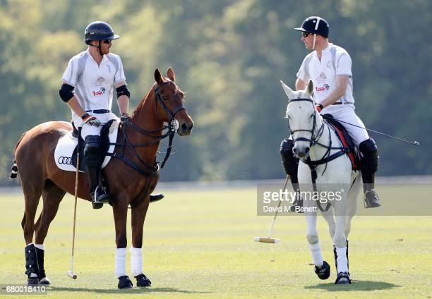 Prince Harry and Prince William Duke of Cambridge attend the Audi Polo Challenge at Coworth Park on May 7 2017 in London United Kingdom