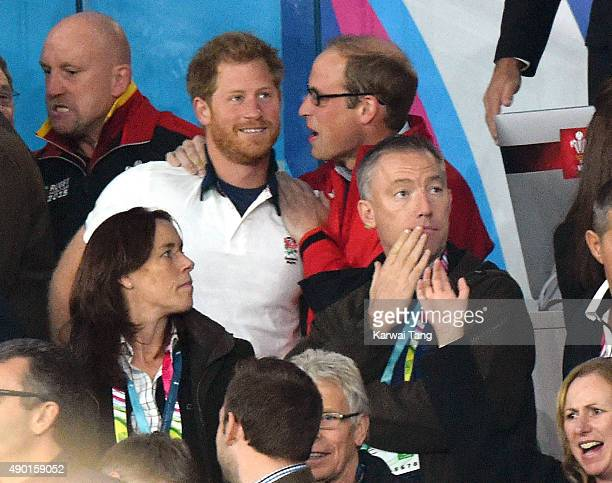 Prince Harry and Prince William Duke of Cambridge attend the England v Wales match during the Rugby World Cup 2015 on September 26 2015 at Twickenham...