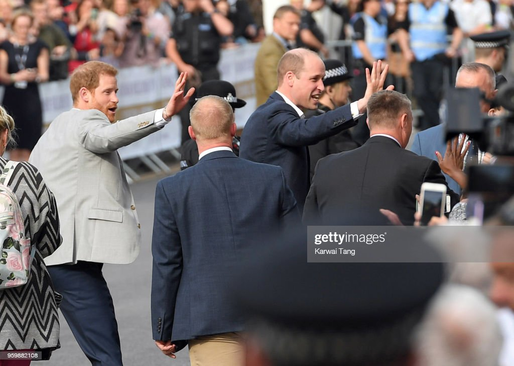 Prince Harry and Prince William, Duke of Cambridge embark on a walkabout ahead of the royal wedding of Prince Harry and Meghan Markle on May 18, 2018 in Windsor, England.