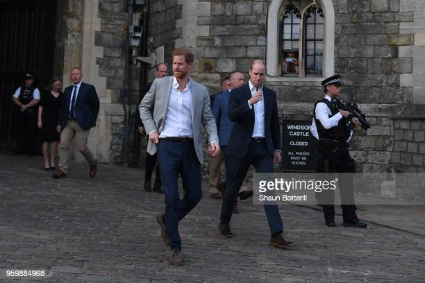 Prince Harry and Prince William Duke of Cambridge embark on a walkabout ahead of the royal wedding of Prince Harry and Meghan Markle on May 18 2018...