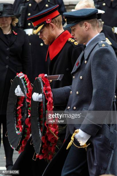 Prince Harry and Prince William Duke of Cambridge lay wreaths during the annual Remembrance Sunday memorial on November 12 2017 in London England The...