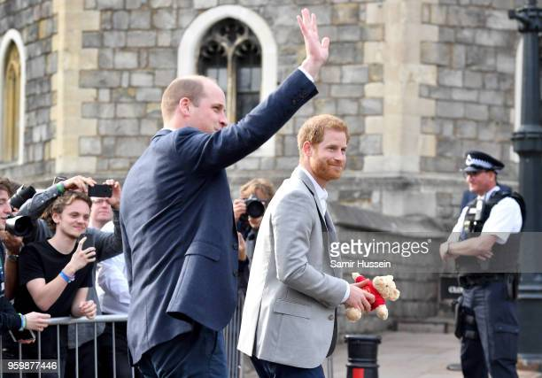 Prince Harry and Prince William Duke of Cambridge meet the public during a walkabout in Windsor on the eve of the wedding at Windsor Castle on May 18...