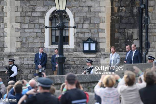 Prince Harry and Prince William Duke of Cambridge meet the public during a pre wedding walkabout ahead of the royal wedding of Prince Harry to Meghan...