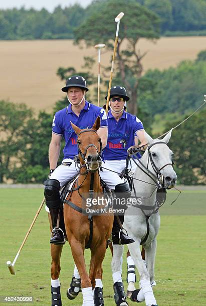 Prince Harry and Prince William Duke of Cambridge play during the Kent and Curwen Royal Charity Polo Cup at Watership Down Sydmonton Court Estate on...