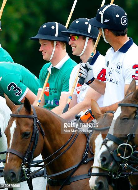 Prince Harry and Prince William Duke of Cambridge play in the Jerudong Trophy charity polo match at Cirencester Park Polo Club on June 15 2014 in...
